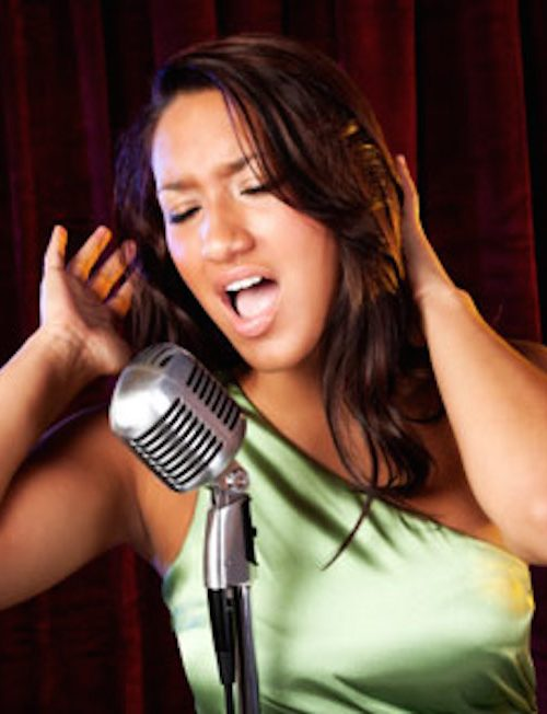 Woman-Singing-into-retro-microphone460x300